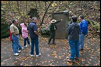 Ranger pointing to cave entrance to visitors. Mammoth Cave National Park, Kentucky, USA.
