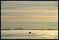 Boaters in fog, early morning, Kabetogama lake. Voyageurs National Park, Minnesota, USA. (color)