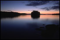 Sunset with moon on island on Kabetogama Lake near Ash river. Voyageurs National Park, Minnesota, USA.