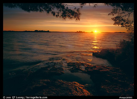 Sun rising over Kabetogama Lake. Voyageurs National Park, Minnesota, USA.