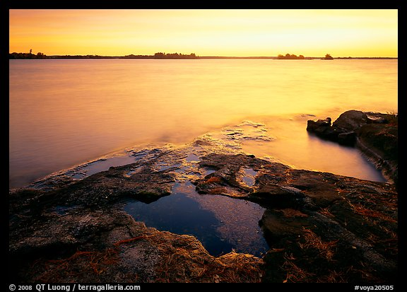 Lake and eroded granite at sunrise. Voyageurs National Park (color)