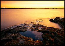Lake and eroded granite at sunrise. Voyageurs National Park, Minnesota, USA.