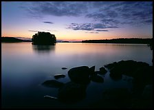 Kabetogama lake sunset with eroded granite and tree-covered islet. Voyageurs National Park, Minnesota, USA.