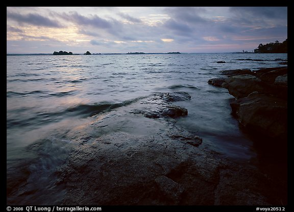 Lakeshore with eroded granite slab and clouds. Voyageurs National Park (color)