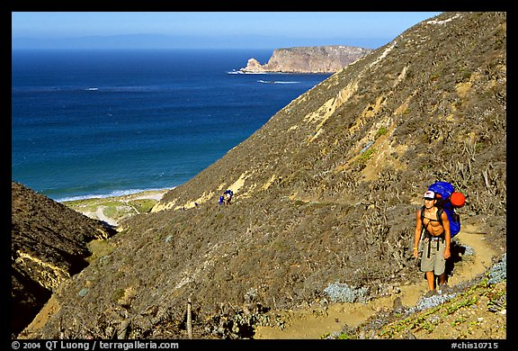 Backpacker going up Nidever canyon trail, San Miguel Island. Channel Islands National Park (color)
