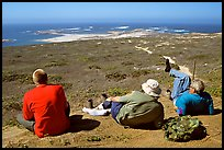 Hikers observing Point Bennett from a distance, San Miguel Island. Channel Islands National Park, California, USA. (color)