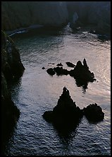 Rocks and ocean, Cathedral Cove, Anacapa, late afternoon. Channel Islands National Park, California, USA.