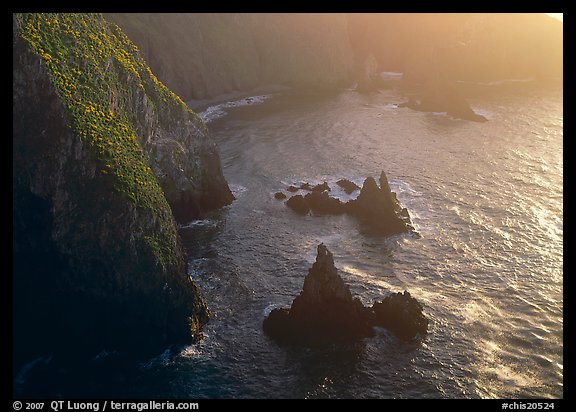Cliffs and pointed rocks, Cathedral Cove, late afternoon, Anacapa Island. Channel Islands National Park, California, USA.