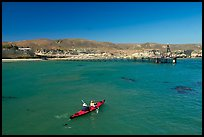Kayakers in Bechers Bay, Santa Rosa Island. Channel Islands National Park, California, USA. (color)