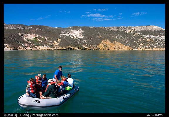 Campers using a skiff to land, San Miguel Island. Channel Islands National Park (color)
