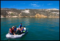 Campers using a skiff to land, San Miguel Island. Channel Islands National Park, California, USA.