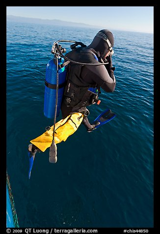 Scuba diver jumping from boat. Channel Islands National Park (color)
