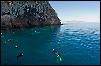 Divers, emerald waters, and steep cliffs, Annacapa island. Channel Islands National Park, California, USA.