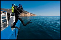 Scuba diver stepping out of boat, Santa Cruz Island. Channel Islands National Park, California, USA. (color)