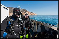 Scuba divers in wetsuits ready to dive from boat, Santa Cruz Island. Channel Islands National Park, California, USA. (color)
