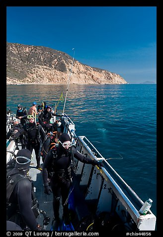Divers in full wetsuits on diving boat, Santa Cruz Island. Channel Islands National Park, California, USA.