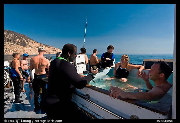 Divers in hot tub aboard the Spectre dive boat, Santa Cruz Island. Channel Islands National Park (color)