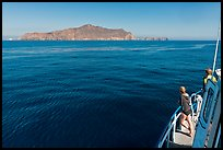 Woman on boat cruising towards Annacapa Island. Channel Islands National Park, California, USA. (color)