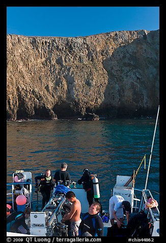Dive boat and cliffs, Annacapa Island. Channel Islands National Park, California, USA.