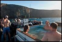 Divers relaxing in hot tub aboard the Spectre and Annacapa Island. Channel Islands National Park, California, USA.