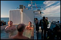 Soaking in hot tub on diving boat, Annacapa Island. Channel Islands National Park, California, USA. (color)