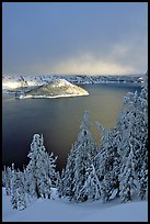 Lake and Wizard Island, winter sunrise. Crater Lake National Park, Oregon, USA.