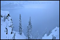 Trees and mistly lake in winter. Crater Lake National Park, Oregon, USA. (color)