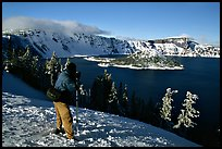 Photographer on  rim of  Lake in winter. Crater Lake National Park ( color)