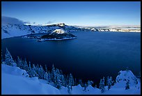 Wizard Island and lake in late afternoon shade, winter. Crater Lake National Park, Oregon, USA.