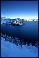 Wizard Island and lake in winter, late afternoon. Crater Lake National Park, Oregon, USA.