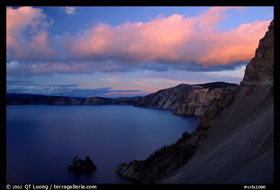 Phantom ship and lake seen from Sun Notch, sunset. Crater Lake National Park, Oregon, USA.