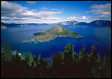 Wide view of lake with Wizard Island, afternoon. Crater Lake National Park, Oregon, USA.