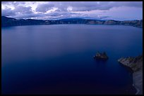 Phantom ship and lake seen from Sun Notch, dusk. Crater Lake National Park, Oregon, USA. (color)