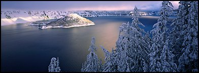 Light on the lake, winter sunrise. Crater Lake National Park, Oregon, USA.