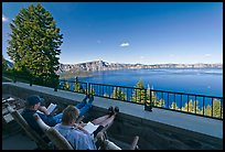 Reading on Crater Lake Lodge Terrace overlooking  Lake. Crater Lake National Park ( color)