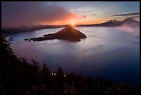 Wide view with sunrise and clouds. Crater Lake National Park, Oregon, USA.