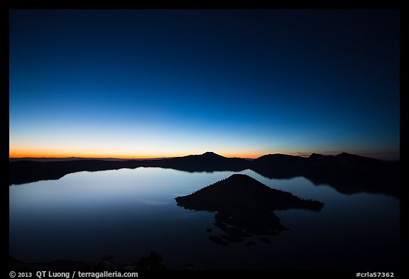 Wide view of lake with dawn on eastern horizon. Crater Lake National Park (color)