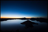 Wide view of lake with dawn on eastern horizon. Crater Lake National Park ( color)