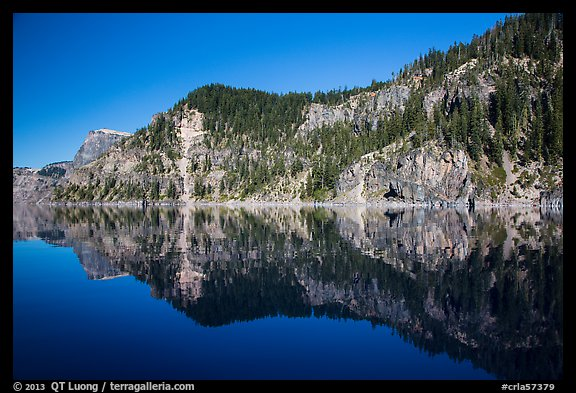Cliffs reflected in calm waters. Crater Lake National Park (color)