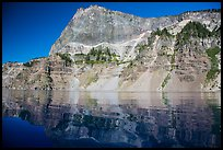 Llao Rock reflected in rippled water. Crater Lake National Park ( color)