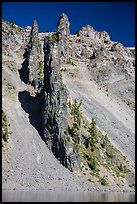 Devils Backbone, vertical dike of dark andesite lining the cliff face. Crater Lake National Park ( color)