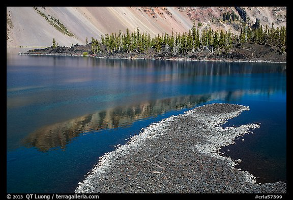 Lava rocks and reflections in Fumarole Bay, Wizard Island. Crater Lake National Park (color)