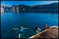 Girls swim from Wizard Island dock. Crater Lake National Park ( color)