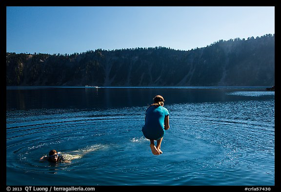 Girl jumps in water in Governors Bay, Wizard Island. Crater Lake National Park (color)