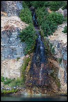 Chaski Slide waterfall flowing into lake. Crater Lake National Park ( color)
