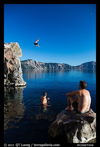 Man jumping from cliff as others look, Cleetwood Cove. Crater Lake National Park (color)