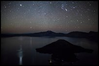 Stars and reflections over lake. Crater Lake National Park, Oregon, USA.