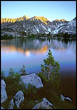 Boulders, tree, and Woods Lake at sunset. Kings Canyon National Park, California, USA.