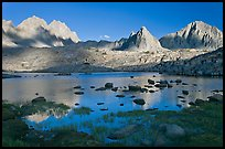North Palissade, Isocele Peak and Mt Giraud reflected in lake, Dusy Basin. Kings Canyon National Park, California, USA.