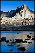 Isocele Peak reflected in lake, late afternoon, Dusy Basin. Kings Canyon National Park, California, USA.